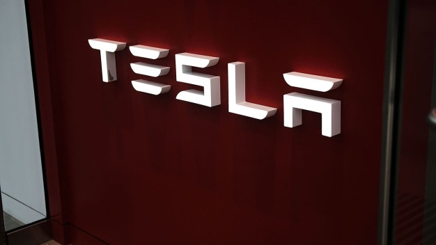Tesla Plans to Cut 7 Percent of Its Workforce