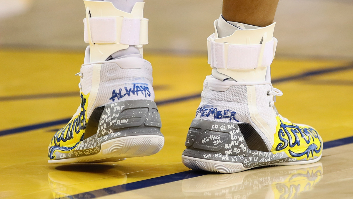 A close-up of the shoes that Stephen Curry wore during the Golden State Warriors' game against the New York Knicks at ORACLE Arena on December 15, 2016, in Oakland, California. The shoes are a tribute to all the lives that were lost in the Ghost Ship warehouse fire in Oakland on December 2. (Photo by Ezra Shaw/Getty Images)