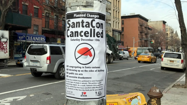 Group Posts Fake 'SantaCon Cancelled' Signs Across NYC