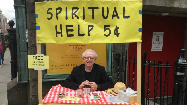 Local Pastor Offers Prayers at Five-Cent Prayer Booth Inspired by 'Peanuts'