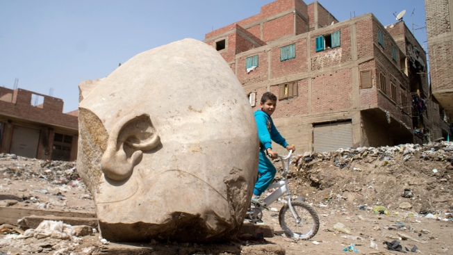 Egypt Archaeologists Discover Massive Statue in Cairo Slum