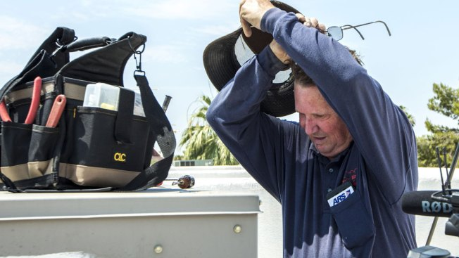 Air Conditioner Repairmen in Hot Demand Amid Heat Wave