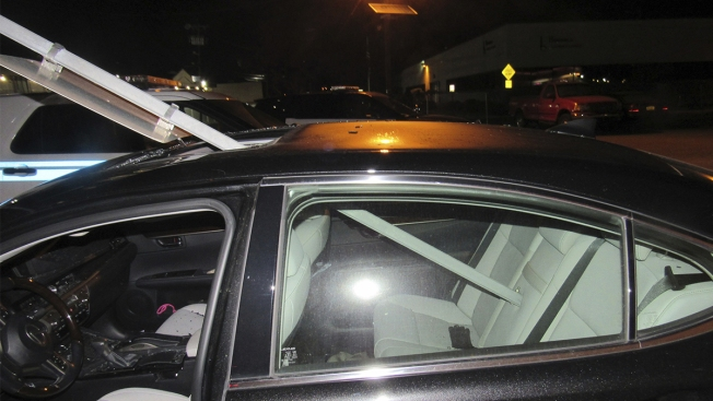 Alleged Drunk Woman Drives With Traffic Sign Through Roof