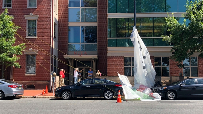 Airplane-Towed Banner Falls Near New Jersey Statehouse, Smashes Car Window
