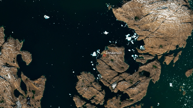 Iceberg Looming Over Greenland Village Spotted From Space