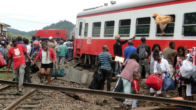 Rescuers work to assist victims of deadly Cameroon rail accident