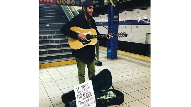 Generous Guitar-Playing Busker Creates 'Hopeful Cases' for NYC's Homeless