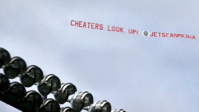 Jets Fans Fly 'Cheaters Look Up!' Banner Over Patriots Practice