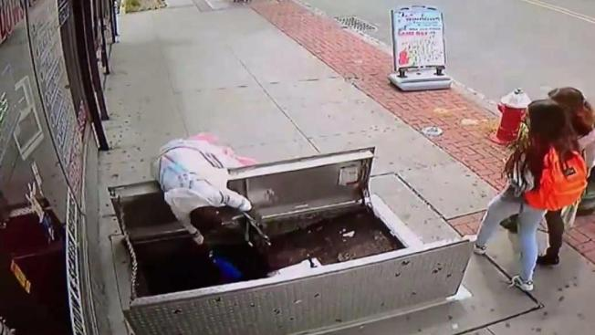 Woman On Phone Tumbles Down Sidewalk Opening In New Jersey