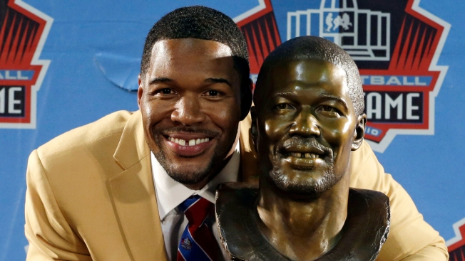 Strahan Laughs, Reed Packs Emotion at Hall of Fame