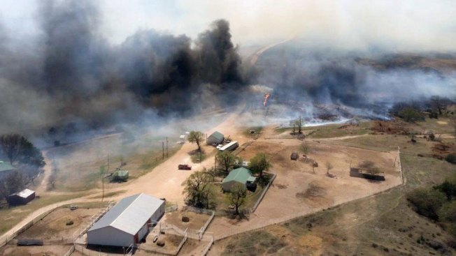 Crews fighting Kansas wildfires get assist from snow, rain