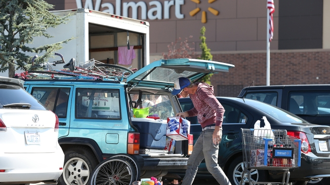 """Burners"" Rained Out of Burning Man Converge on Wal-Mart"