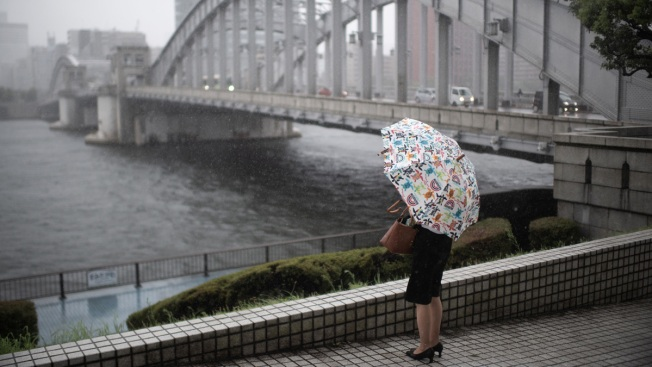 Tropical Storm Hits Japan, Heads for Hard-Hit Western Region