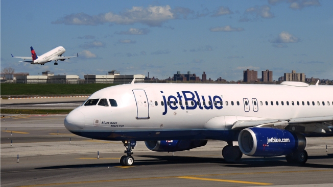 Woman, 61, Punches Fellow Passenger While Getting off JetBlue Flight at JFK, Gets Pepper-Sprayed: Police