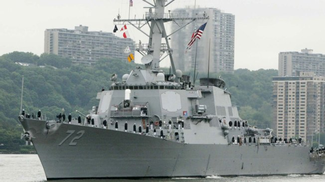 US Warship Fires Warning Shots After Iranian Boats Approach at High Speeds
