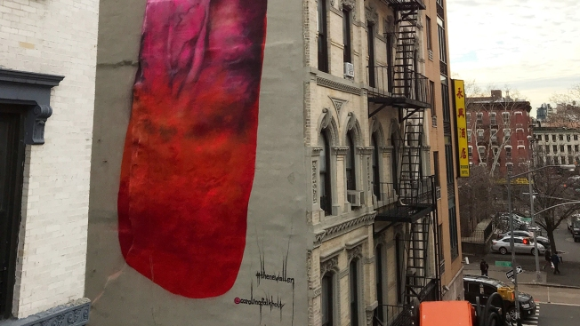 4 story phallic painting pops up on side of nyc building for Celebrity mural