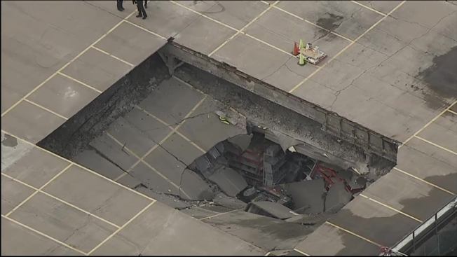 Construction Equipment Plunges Through Roof Of Yonkers Store - National wholesale liquidators flooring