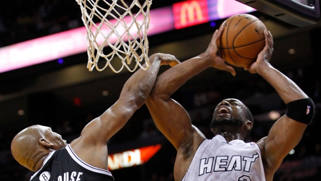 Wade's 34 Lifts Heat Over Nets