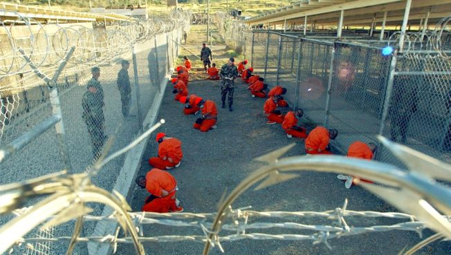 Obama Signs Order to Shut Gitmo
