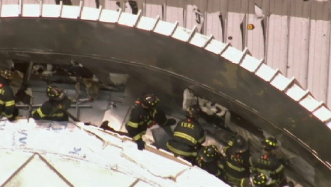 Firefighters Battle Fire on Roof of Fulton Street Transit Center in Blazing Heat