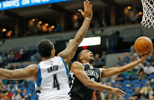 Sharpshooting T'Wolves Bury Nets 132-118