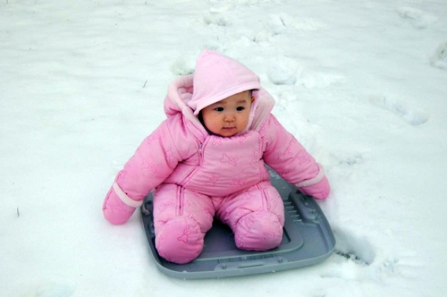 Shoppers, Sledders Make the Best of a Snowy Sunday
