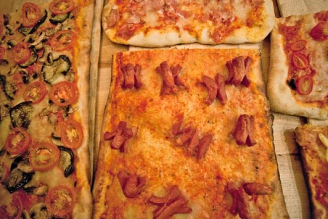 Crimes Against Pizza: Hot Dog Pie Spreads to Manhattan