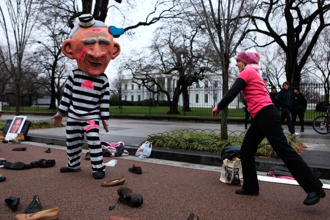 Anti-War Activists Throw Shoes Outside White House