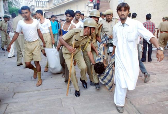 India Temple Stampede Kills 100