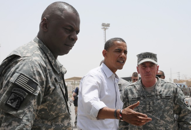 Obama Slows Down Troop Boost Decision