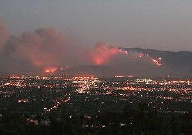 Wind-Driven Wildfires North of Los Angeles Claim Two Lives