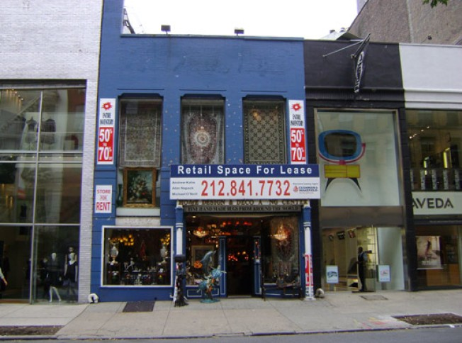 Discontinued: Antiques Shop Bows Off West Broadway