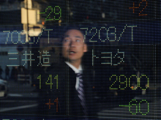 Asian Markets Mixed After Japan Rate Cut