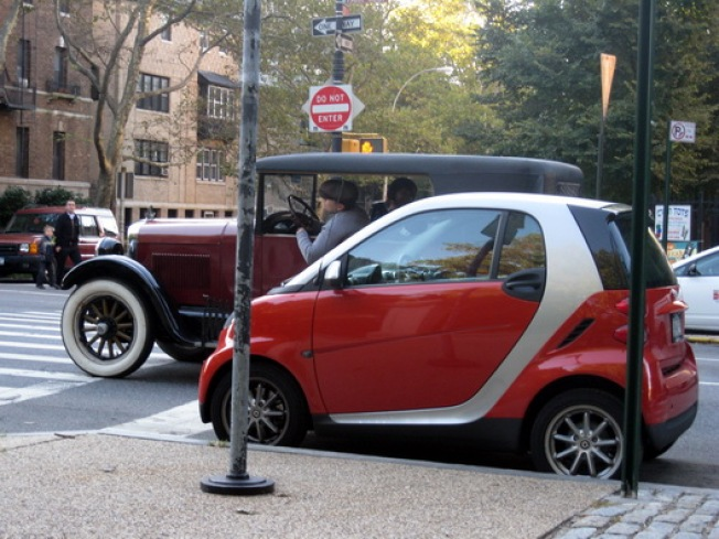 Signs of Gentrification & Lust: Old Car Hits on Slope Smart Car
