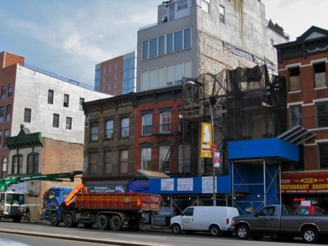 On the Bowery: One Goes Up, the Other Comes Down