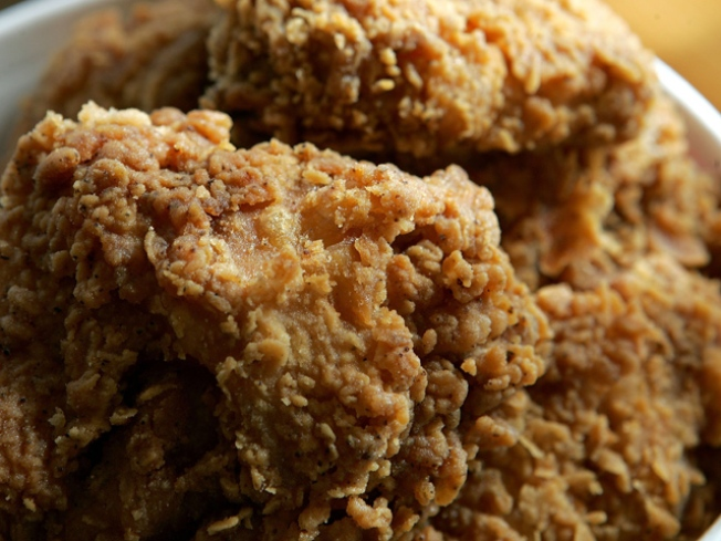 Temple Bomb Bunglers Employ Fried-Chicken Defense