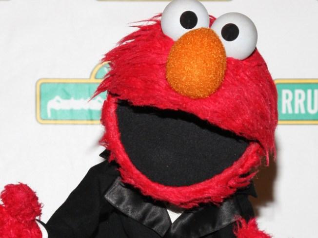 Sesame Creep Elmo Begs Tourists for Cash