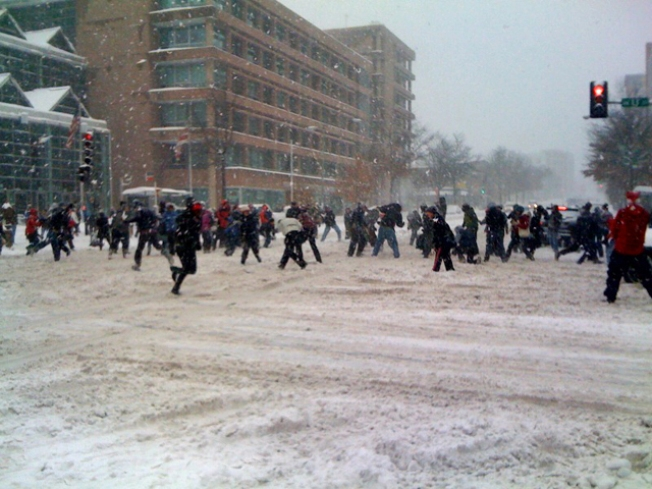 D.C. Cop Brings Gun To Snowball Fight as New York City's Went On Uninterrupted