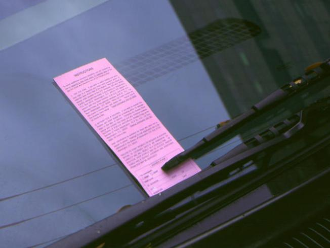 Workers Canned for Fixing Families' Parking Tickets