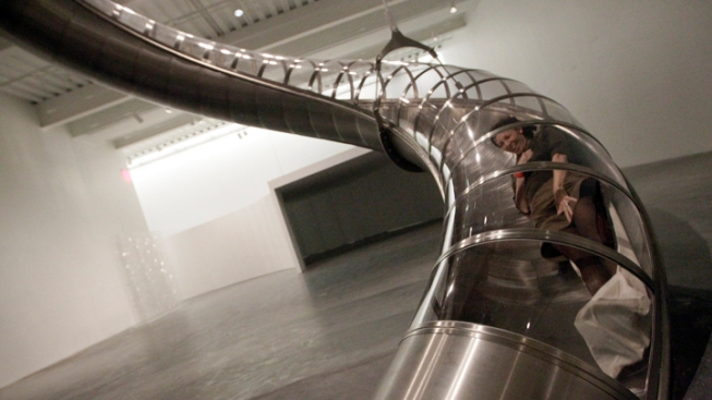 Visitors Ride 3-Story Slide at NYC Museum