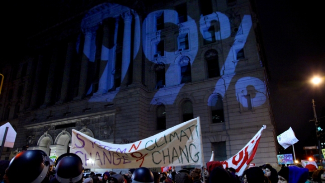 "Occupy Wall Street Stages ""War Profiteers"" Protest"