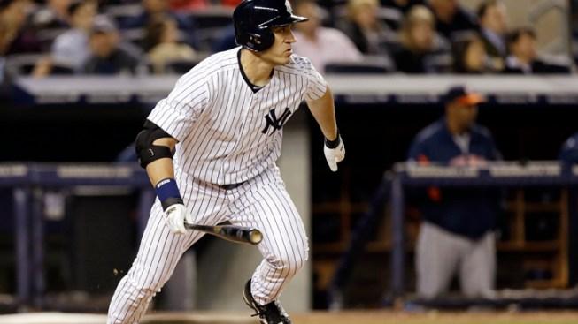 Kuroda and Hafner Lead Yankees Over Astros 7-4