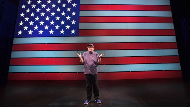 Review: Michael Moore, Preaching to the Converted in Slick 'Surrender'