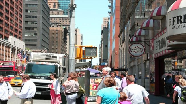 DOT Unveils New Street Signs to Help Pedestrians