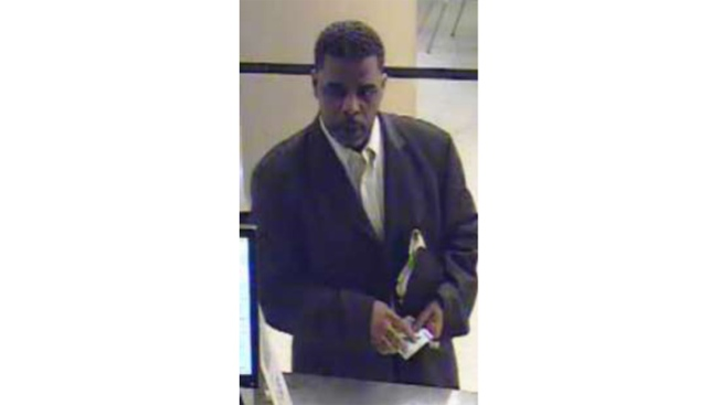 FBI Hunts Dapper Bank Bandit Who Robs in a Suit