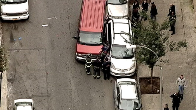 Pedestrian Pinned Between Two Cars in Bronx