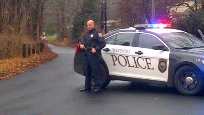 Masked Man in Black Carrying Umbrella Mistaken for Gunman in Conn.