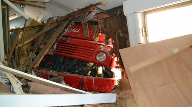 Street Sweeper Crashes Into House After Parking Brake Released