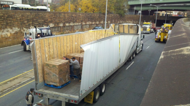 Truck Loses Top on Low Overpass Along Queens Boulevard