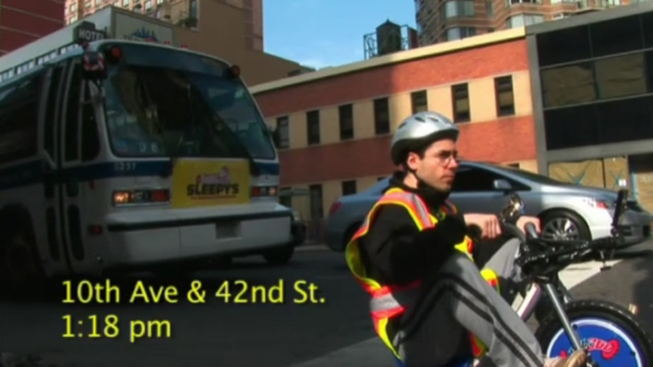 Man on Tricycle Outspeeds 42nd Street Bus